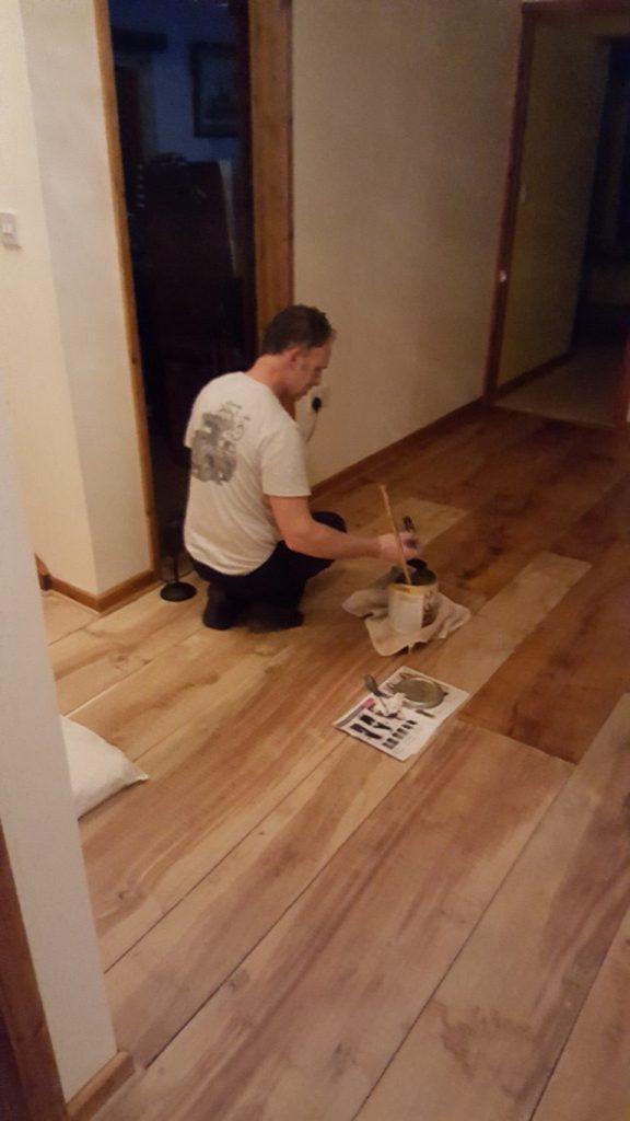 Hard at Work Cleaning Floors in Devon
