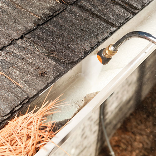 Cleaning & restoration for guttering using a pressure washer